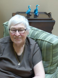 Photo of private care client Carole Ward relaxing at home.