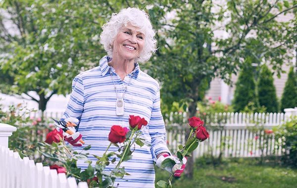 Older Woman gardening roses Philips Lifeline